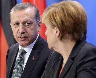Erdoğandan Merkele kritik uyarı